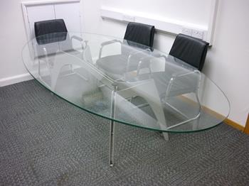 Glass oval boardroom table
